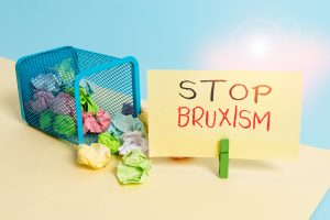 Handwriting text writing Stop Bruxism. Conceptual photo put an end to a condition which you grind or clench the teeth Trash bin crumpled paper clothespin empty reminder office supplies tipped