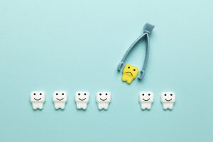 Baby tooth extraction. Surgery of children's teeth, concept.