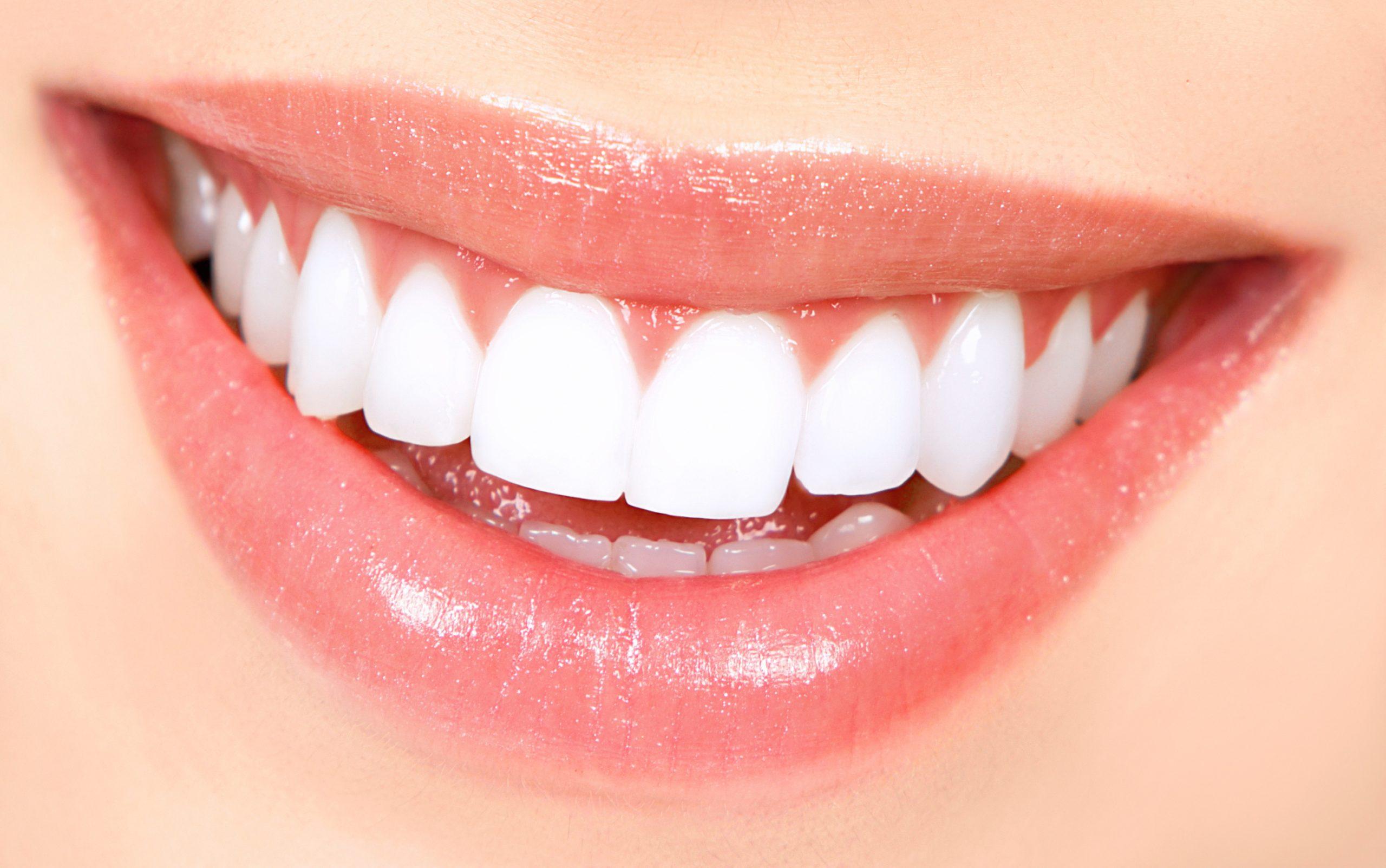 Beautiful young woman teeth. Close up