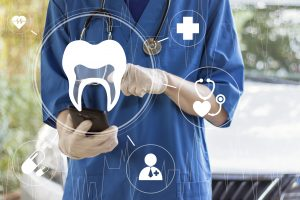 Doctor pressing button stomatology tooth healthcare on virtual panel medicine.