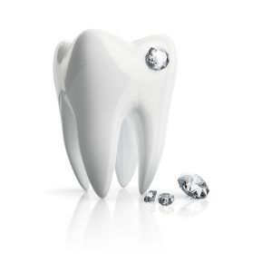 Close-up tooth piercing crystal isolated on a white background